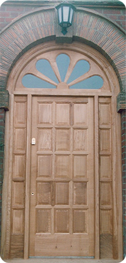 Door with panels to match side panes and detail transom light over