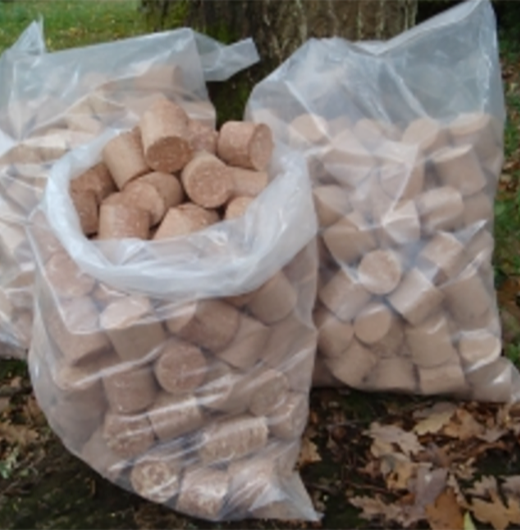 wood briquettes, bagged for log burners