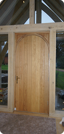 Oak door with radius top into square frame