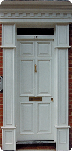 Painted entrance door with pilasters and cornice
