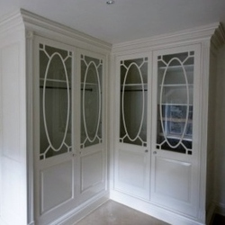 Twin fitted wardrobe in dressing room